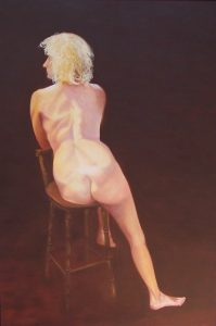Back view of Ruth seated on a stool