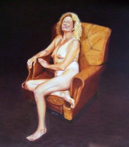Ruth Series, seated in a leather chair looking left