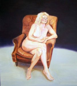 Ruth Series, seated in a leather chair looking right